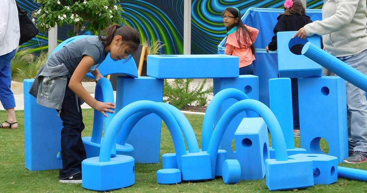 Big Blue Blocks on the lawn at Hemisfair